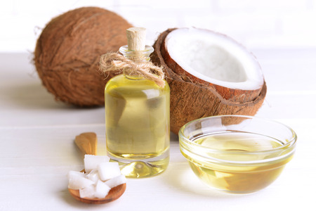 oil massage: Coconut oil on table on light background