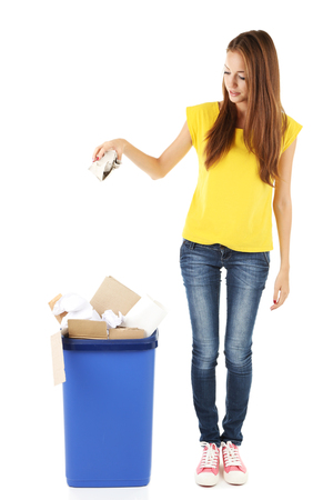 Young girl sorting paper and cardboard isolated on white Stock Photo