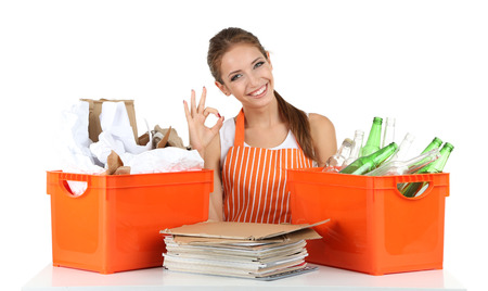 Young girl waste sorting isolated on white