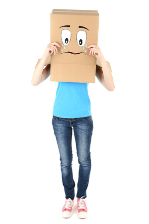 Woman with cardboard box on her head with sad face, isolated on white photo