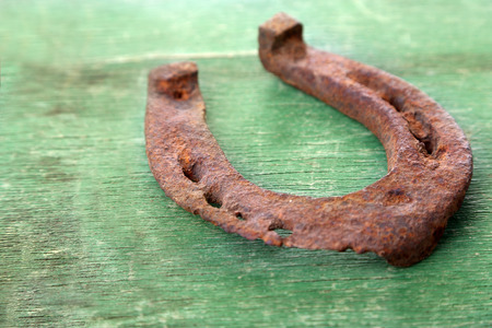 accessories horse: Old horse shoe on wooden background