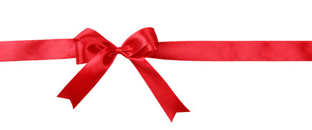 red silk: Shiny red ribbon with bow isolated on white