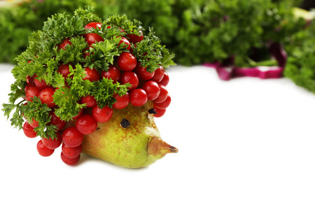 Healthy eating. Hedgehog made of vegetables and fruits, close up photo
