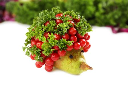Hedgehog made of vegetables and fruits, close up photo