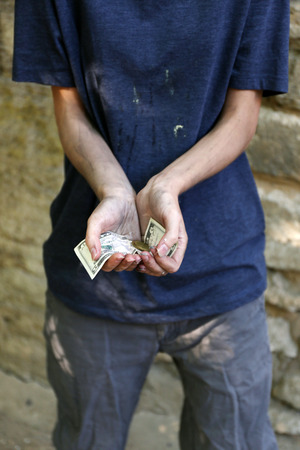 dirty hands: Homeless beggar money on his dirty hands Stock Photo