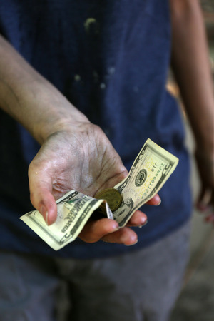 priceless: Homeless beggar money on his dirty hands Stock Photo