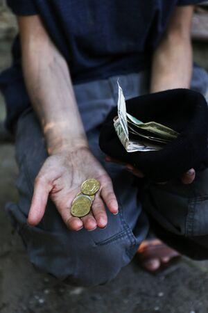 the merciful: Homeless beggar money