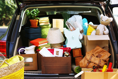 Moving boxes and suitcases in trunk of car, outdoors Archivio Fotografico