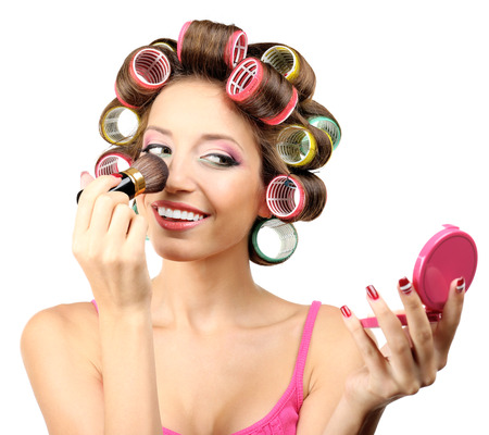 Beautiful girl in hair curlers isolated on white Stock Photo