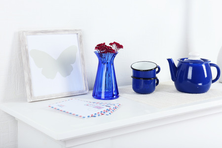 white shelf: Different objects on white shelf in living room
