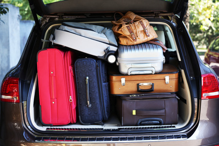 holiday: Suitcases and bags in trunk of car ready to depart for holidays
