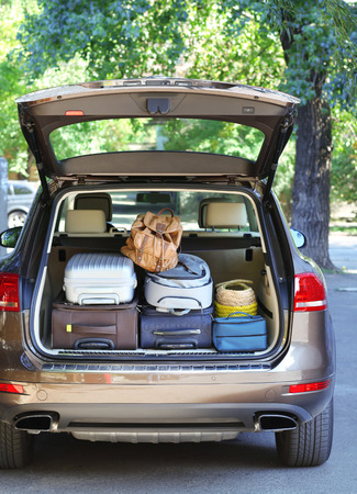 Suitcases and bags in trunk of car ready to depart for holidays Stock Photo - 38308011