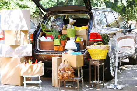 Moving boxes and suitcases in trunk of car, outdoors Imagens