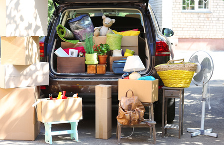 full: Moving boxes and suitcases in trunk of car, outdoors Stock Photo