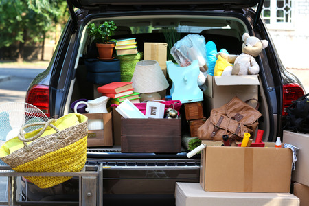necessary: Moving boxes and suitcases in trunk of car, outdoors Stock Photo