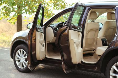 Modern car with open door, outdoors Banque d'images
