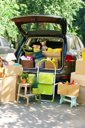 Moving boxes and suitcases in trunk of car, outdoors Stock Photo