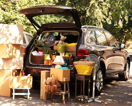 house moving: Moving boxes and suitcases in trunk of car, outdoors Stock Photo
