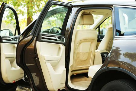 car door: Modern car with open door, outdoors Stock Photo