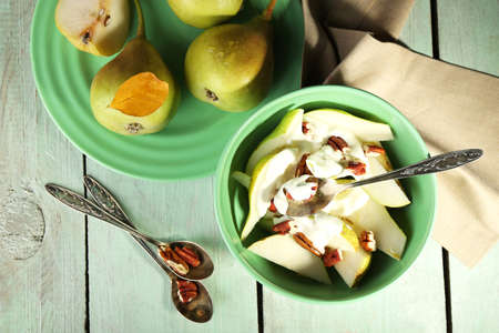 Tasty dessert with pears and fresh pears, on wooden table photo
