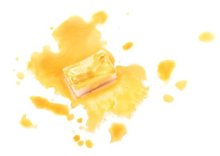 spilled: Watercolor paint cube and spilled paint isolated on white