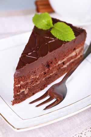 custard slices: Piece of chocolate cake on plate closeup
