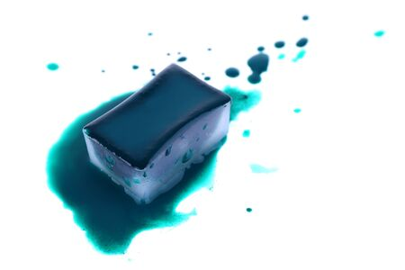 spilled paint: Watercolor paint cube and spilled paint isolated on white