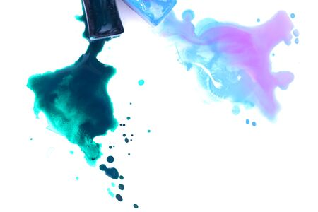 spilled: Watercolor paint cubes and spilled paint isolated on white Stock Photo