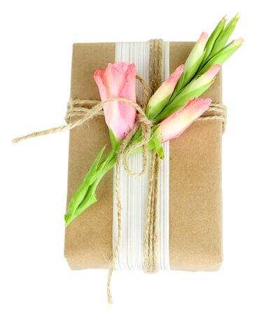 handcrafted: Natural style handcrafted gift box with fresh flowers and rustic twine, isolated on white