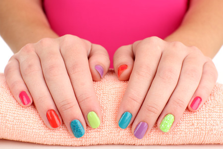 salon background: Woman hands with bright manicure, close-up