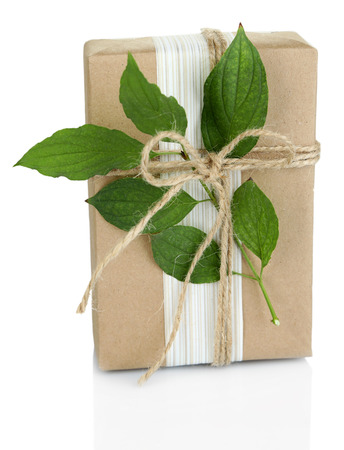 handcrafted: Natural style handcrafted gift box with fresh leaves and rustic twine, isolated on white background