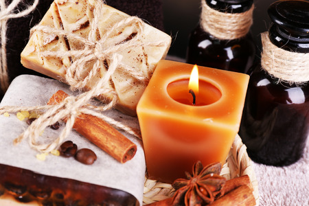 wicker bar: Organic soap with coffee beans, sea salt on wicker mat, on  table background, Coffee spa concept Stock Photo