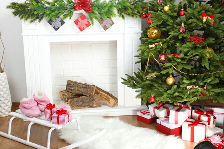 tree decorations: Fireplace with beautiful Christmas decorations in room