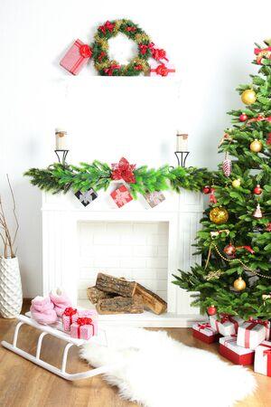 christmas room: Christmas tree near fireplace in room