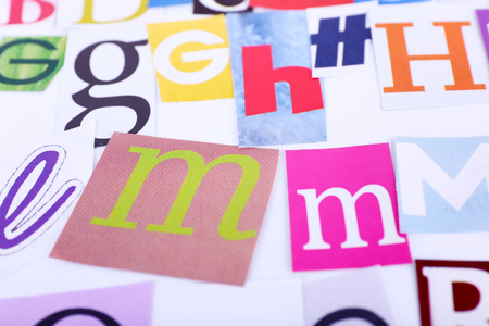 typesetter: Colorful newspaper letters as background