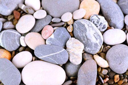mixed wallpaper: Sea stones as background Stock Photo
