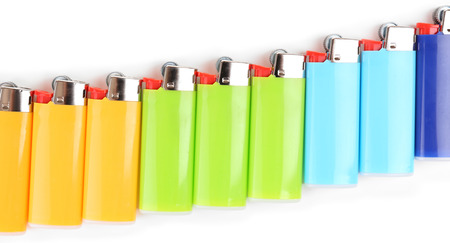 encendedores: Colorful lighters isolated on white