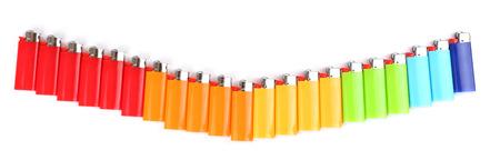 encendedores: Encendedores coloridos aislados en blanco Foto de archivo