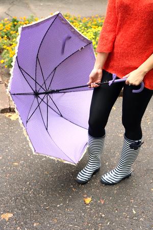 wellingtons: Woman in Boots on rainy autumn day. Stock Photo