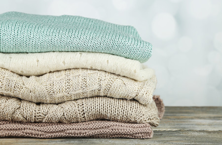 warm cloth: Knitting clothes on light background Stock Photo
