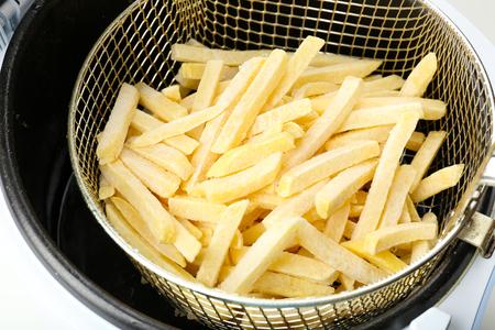 fryer: French fries in deep fryer, closeup