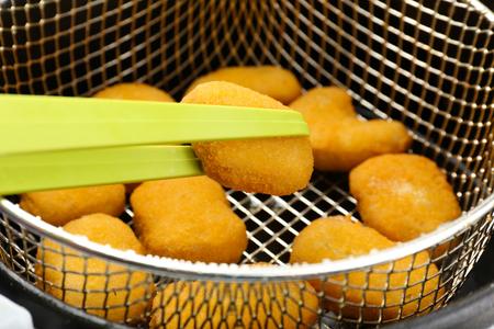 fryer: Cutlets in deep fryer, closeup Stock Photo