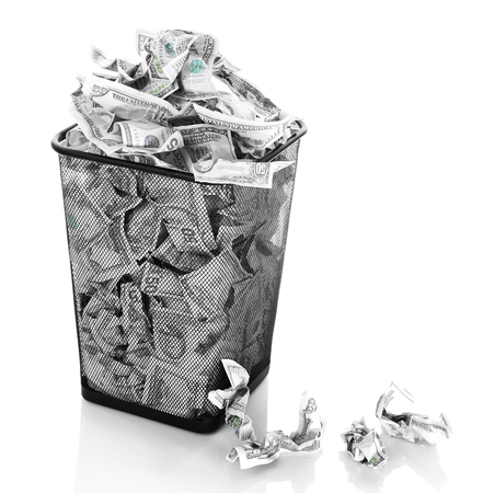 inflation basket: Money in dustbin isolated on white