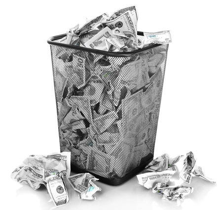 bucket of money: Money in dustbin isolated on white