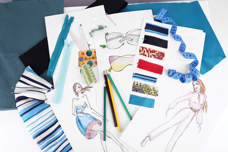 fabric samples: Sketches of clothes and fabric samples on table Stock Photo