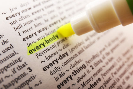 highlighting: Yellow marker highlighting word in dictionary Stock Photo