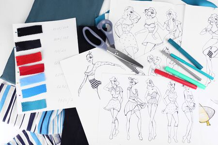 fashion drawing: Sketches of clothes and fabric samples on table Stock Photo