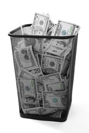 bucket of money: Money in dustbin on grey background