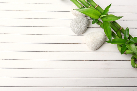 Spa bamboo on wooden background Stockfoto