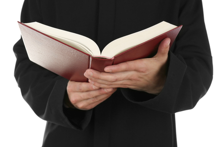 the sermon: Man holding book close up